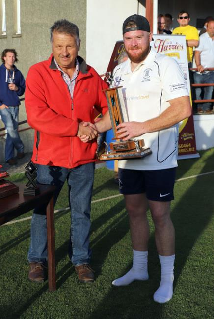 Receiving the man of the match award from Glyn Cole
