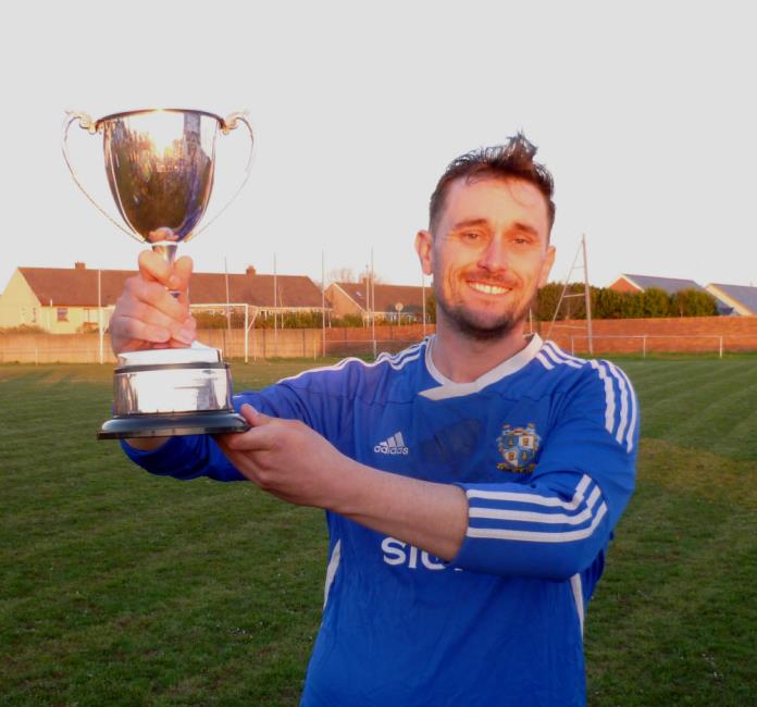 Swifts skipper Joe Boswell raises the cup aloft
