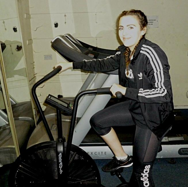 Nia works hard cycling
