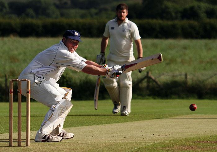 Simon Holliday steers a ball to the boundary