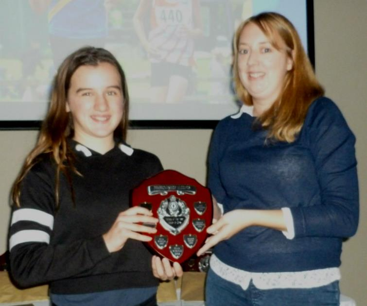 Ella Wintle receiving her trophy at the Pembrokeshire Harriers presentation evening