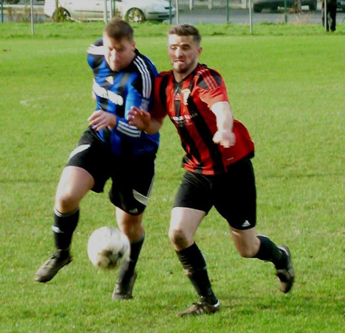 Gareth Fawcett and Wayne OSullivan battle for possession