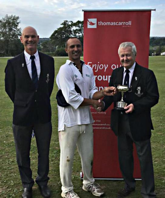 Narberth 2nds skipper Davy Jones receives the Division 2 trophy