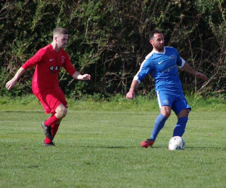 Merlins Bridge goal scorer Peter Thomas on the ball against Pennar Robins