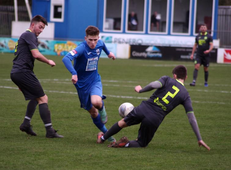 Cambrian and Clydach full back Joe Evans stops Danny Williams with a strong tackle