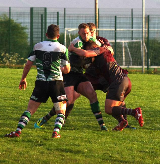 Whitland centre Josh Thomas is stopped in his tracks by Sion Colella