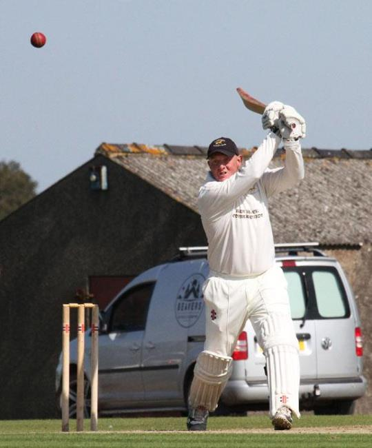 Steve Lewis blasts a six for Lawrenny - Brian McKehon