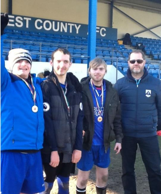 Lewis Davies (Bridgend Herons), Chris McFetrich (Bridgend Herons and Kerry Baker (Bridgend Herons) show off their medals.