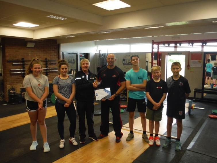Angela Miles and Simon Roach with members of Strength Academy Wales