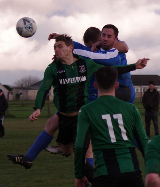 Aerial battle between goal scorers Nicky Woodrow and Richard Hughes in the mouth-watering Senior Cup quarter-final clash between Merlins Bridge and Hakin United