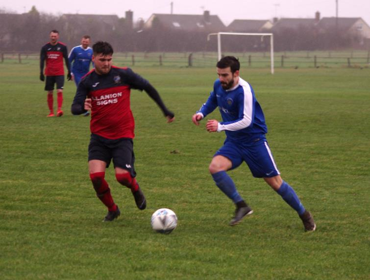 Action from a rain swept Racecourse as Merlins Bridge lost heavily against high-flying Monkton Swifts
