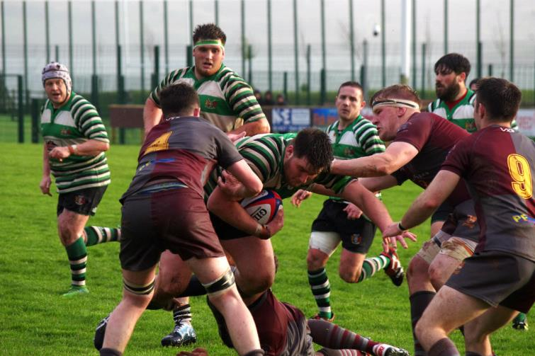 Borderers prop Jimmy Buirds on the charge closely followed by twin brother Scott