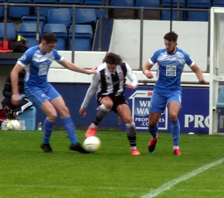 Callum Pratley works hard to keep possession for the Silkmen