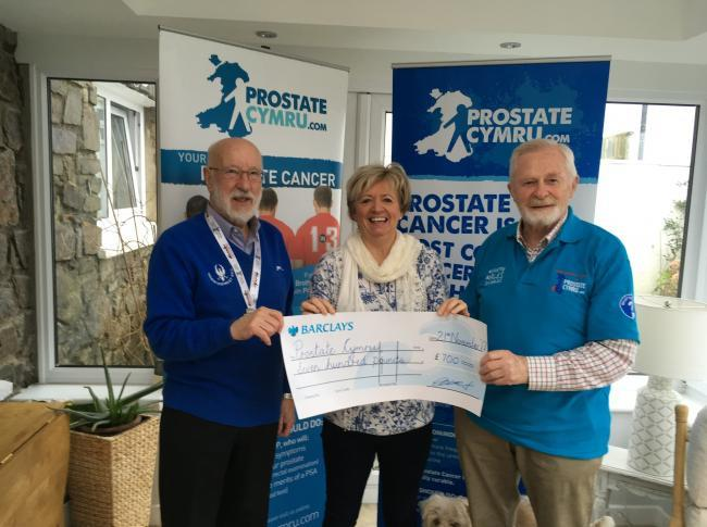 Charles Davies presenting a cheque to Prostate Cymru