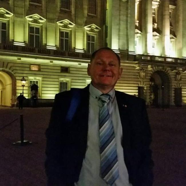 Outside Buckingham Palace in the evening