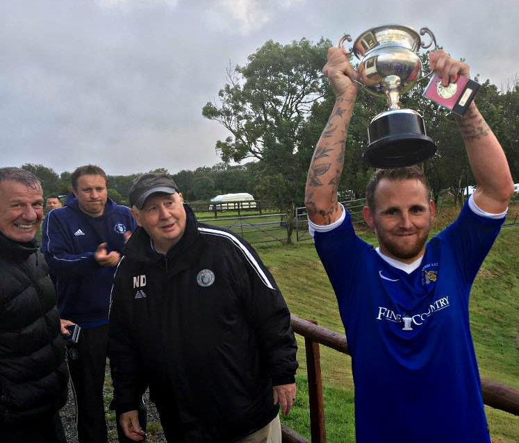 Bridge captain Chris Ormond holds the 2019 Eddie Merry Cup aloft