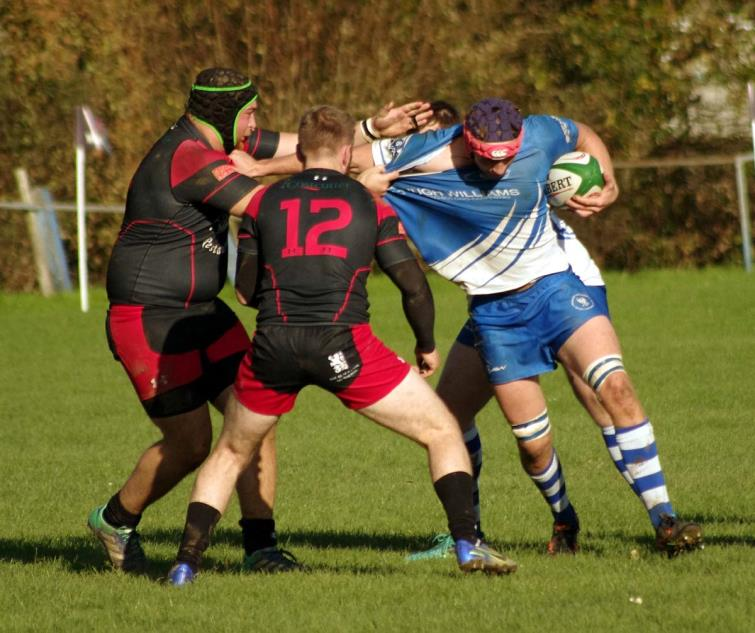 Jack Clancy powers forward for the Blues