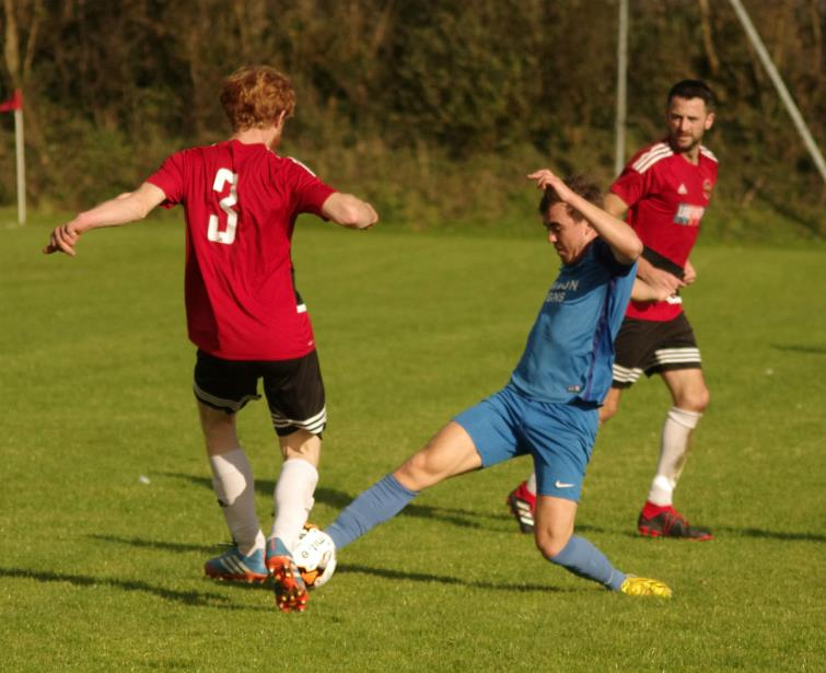 Action from Knock Field where Clarbie Road lost at home to the Swifts