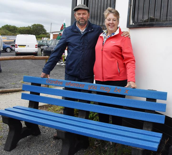 Luke Hardings parents with a bench in memory of their son
