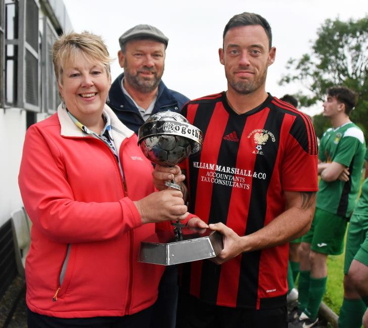 Goodwick skipper Rob Couzens receives the cup