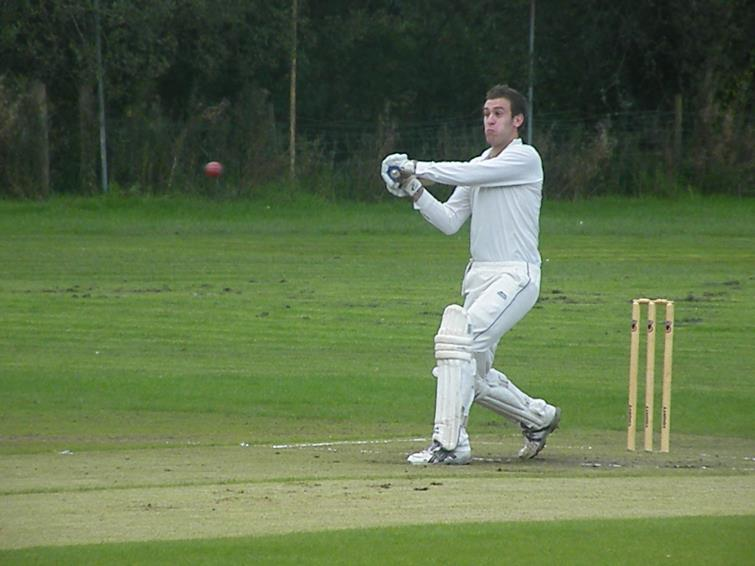 Danny Caine hits a four for Lawrenny