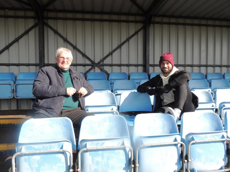 Richards sits watching the game with former chairman David Hughes
