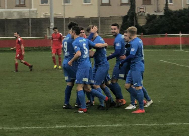 Haverfordwest County players congratulate skipper Sean Pemberton who has scored six goals on the trot