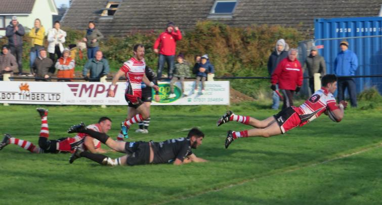 Evan Morgan dives over for a try for Milford Haven