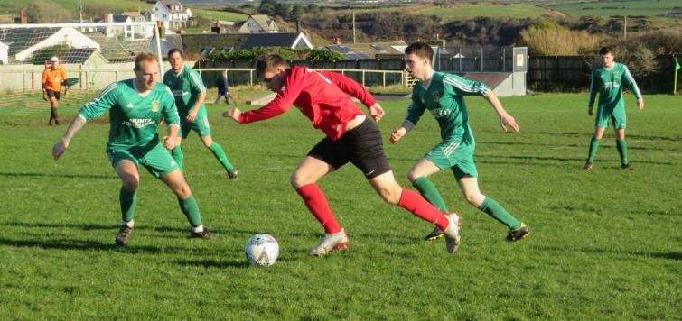 Action from the Senior Cup quarter final tie between Solva versus Carew