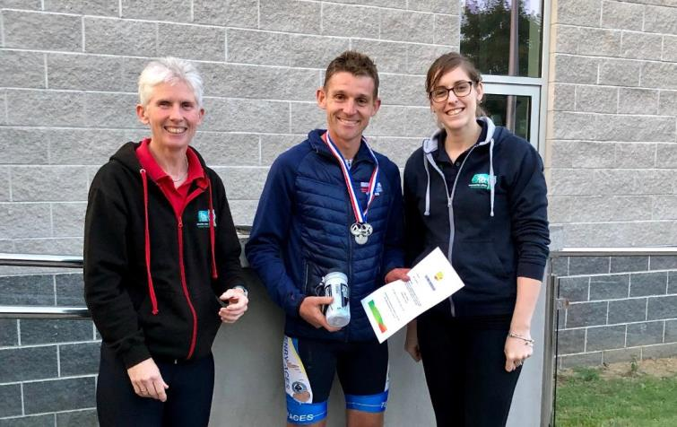 Pictured is Edward Clements, 1st overall male, with Jayne Richards (Go-Tri Co-ordinator) and Lisa Starkey.