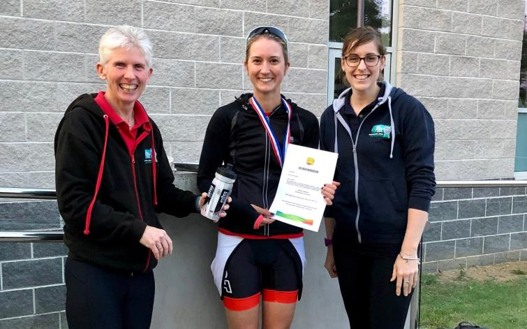 Pictured is Bethan Phillips, 1st overall female, with Jayne Richards (Go-Tri Co-ordinator) and Lisa Starkey