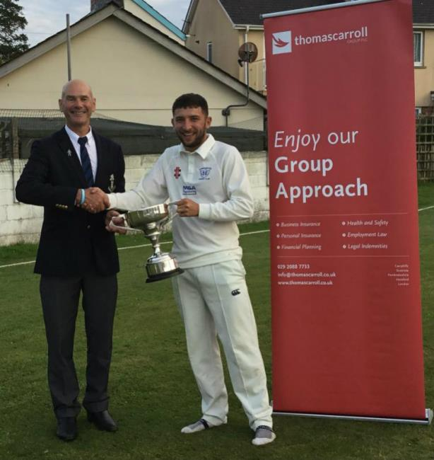 Herbrandston skipper Ryan Davies receives the Division 3 trophy