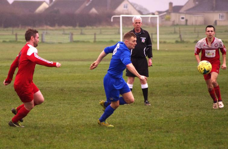 Action from the Racecourse where Merlins Bridge were too strong for Milford United