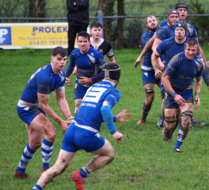Liam Manwaring gets the Blues backs moving