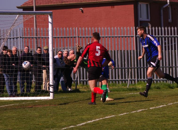 Gareth Fawcett scores with a header for Hakin United who thrashed nine-man Tenby