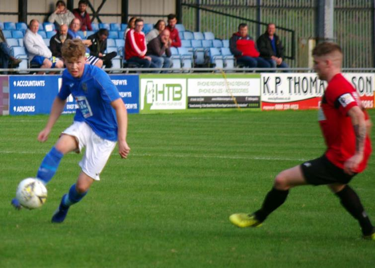 Haverfordwest County left back Harri Rowe has a shot at goal