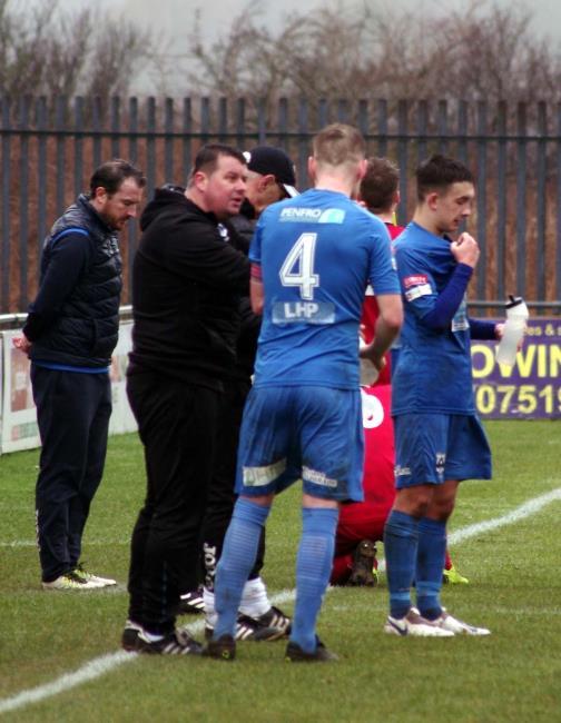Manager Wayne Jones has a word with skipper Sean Pemberton