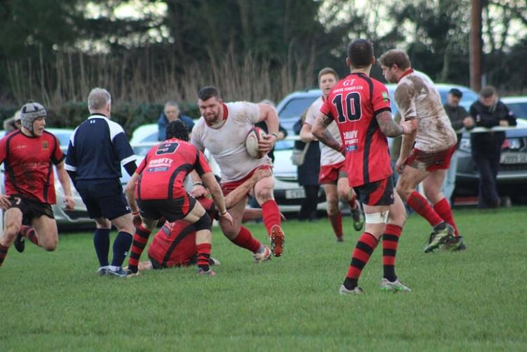 Sam Smith on the charge for Pembroke