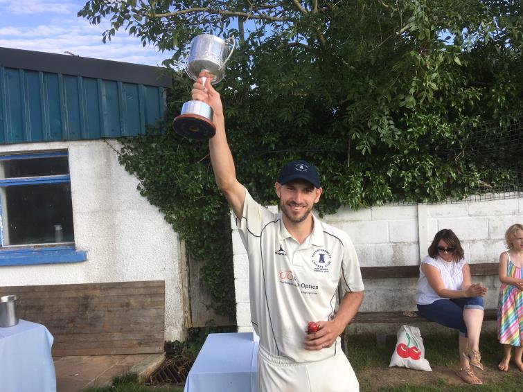 Town 3rds skipper Paul Jenkins holds cup aloft