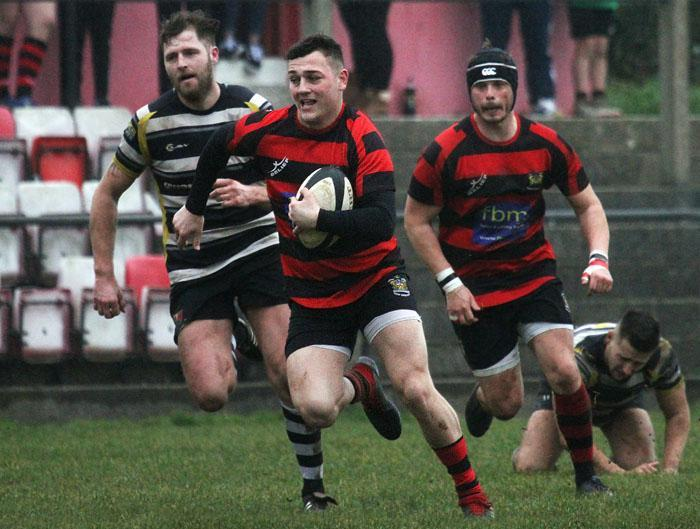 Tenby full back Jack Tucker breaks