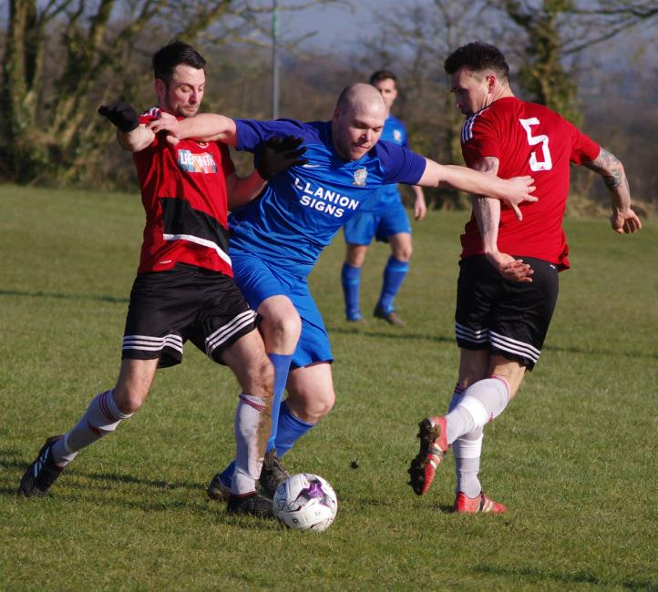 Monkton Swifts James Russell competes strongly with Clarby Road player manager Matthew Ellis