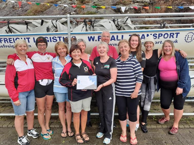 Members of the Fishguard and Goodwick Jemima Rowing Club with Angela Miles.