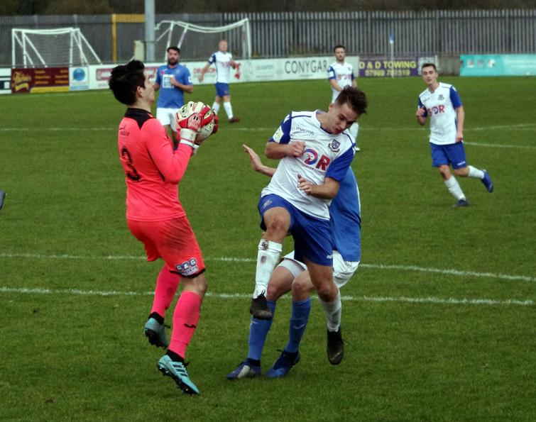 Kyle Stuart collects a ball in the box