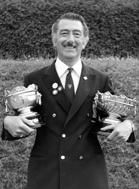 A delighted Les Davies cradles both top trophies, the Alfred Phillips Cup and Sudbury Bowl