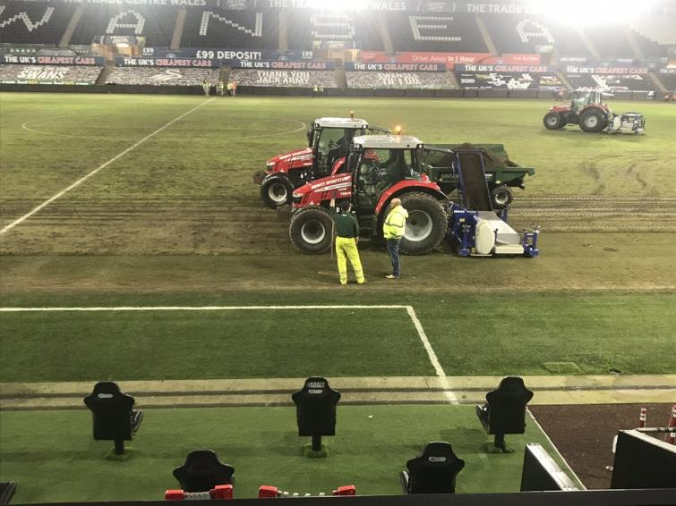 Digging up the pitch after the game