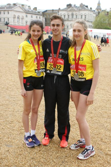 Lucy wins a medal with Harriers team mates