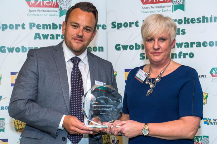 Mel receiving her Sport Pembrokeshire award from Mark Lester