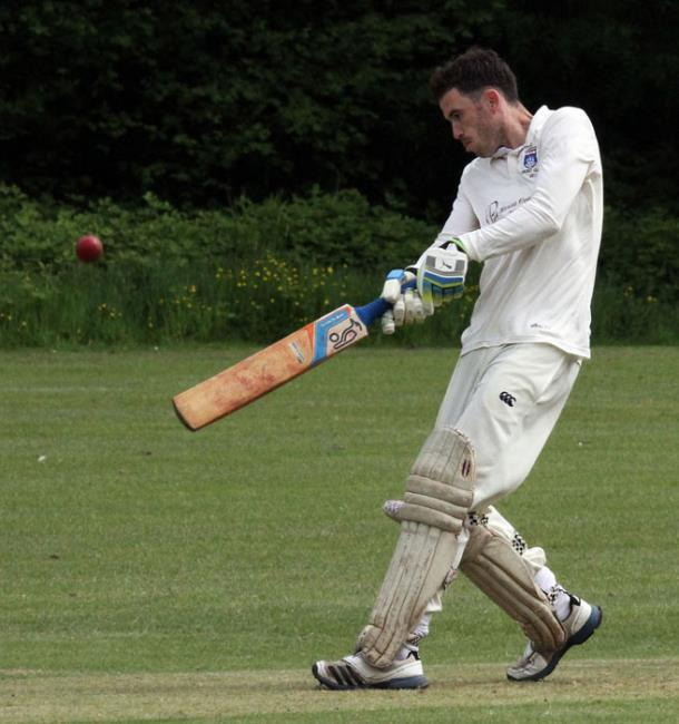 Nick Cope hits a 6 to help Saundersfoot to victory