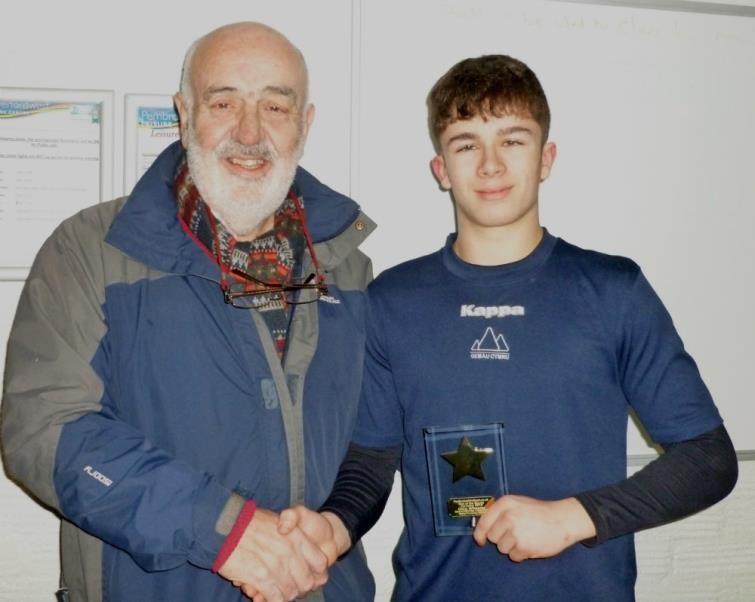 Bill Carne presents star of the month award to Ollie Wheeler