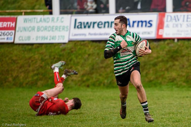 Classy centre Gino Setaro scored a brilliant try hat-trick for Whitland. Picture by Paul Rodgers